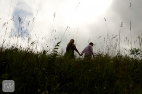 moody_sky_silhouette_rolling_hills_mountain_view_candid_couple_casual_relaxed_portrait_hockley_valley_orangeville_wedding_engagement_photographer_rob_whelan