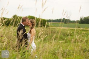 sunset_kiss_field_country_bride_groom_relaxed_portrait_ottawa_yow_wedding_strathmere_rob_whelan_photo